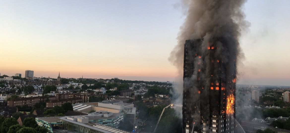 Grenfell Tower on fire above the London skyline on the morning of 14 June 2017.