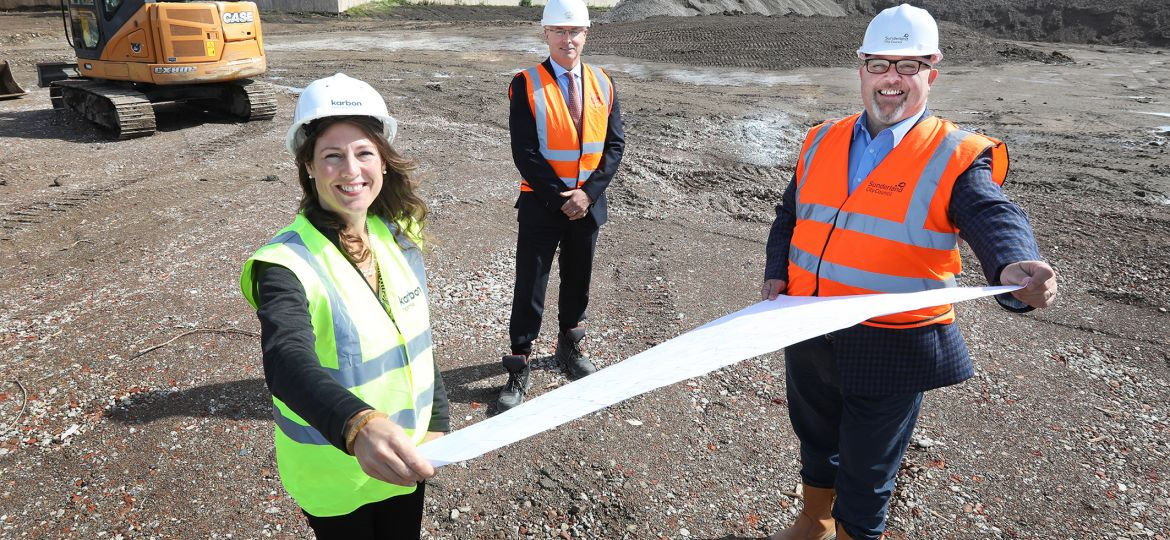 Three people celebrating the start of construction work on a site in North Hylton, Sunderland.