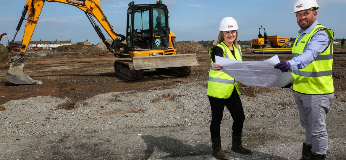 Representatives from Thirteen Homes and Gus Robinson Developments on the Scholars Field construction site in Hartlepool.