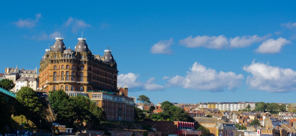 A landscape image of The Grand Hotel and accompanying houses in Scarborough, North Yorkshire, England.