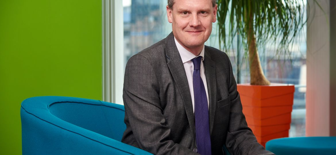 Tim Coolican, head of regulatory at Anthony Collins Solicitors LLP, sat on a blue chair in an office.