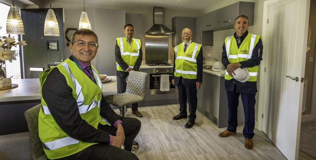 Representatives of Derby City Council with Lovell's East Midlands area director Chris Timmins at Compendium Living's Castleward development in Derby.