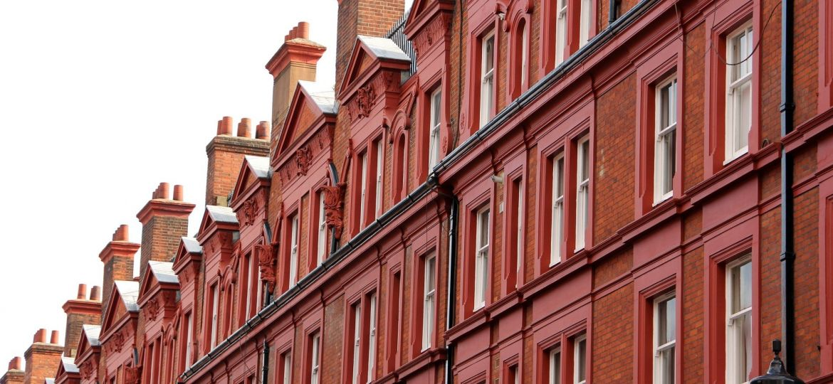 A row of red brick houses in London, England.