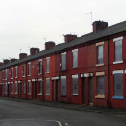 Boarded up red brick terraced houses in Salford.