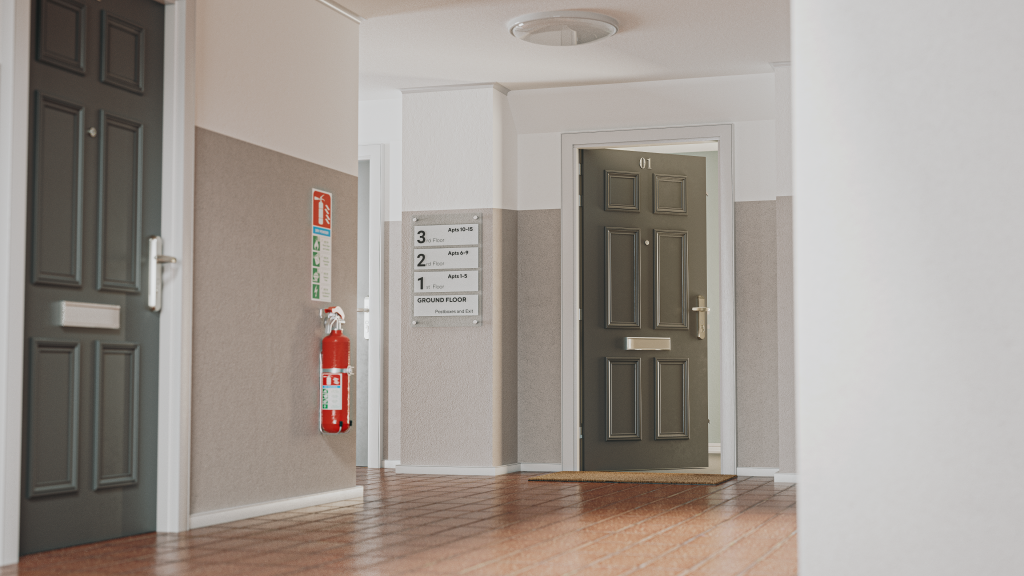A corridor with fire doors installed. There is a fire extinguisher on the wall.