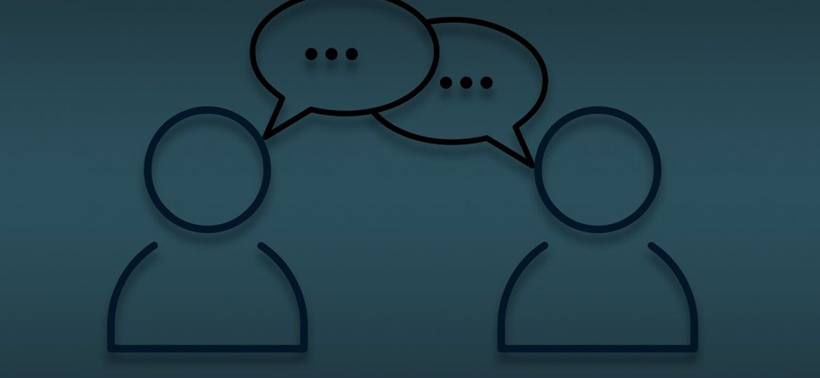 Two people speaking to each other with speech bubbles.