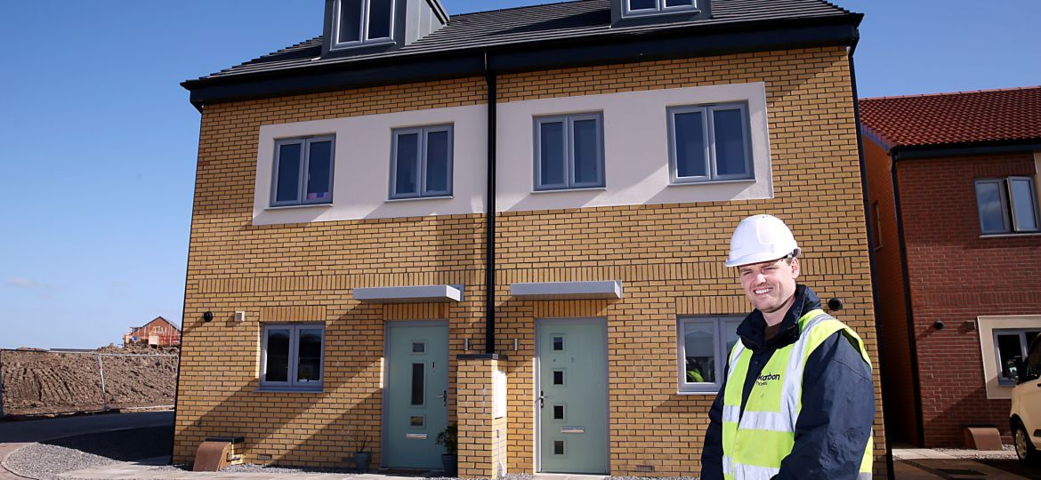 "Shaun Nixon, development contracts officer for Karbon Homes, on site outside a pair of ""Thetford"" semi-detached, modular homes at the Central Park development in Darlington."