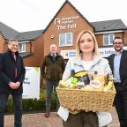 Kate Shotton, the 2,000th DVRC resident, pictured with Ian Prescott (left) and Ian Worgan (second left), of Keepmoat Homes and Cllr Carl Marshall.