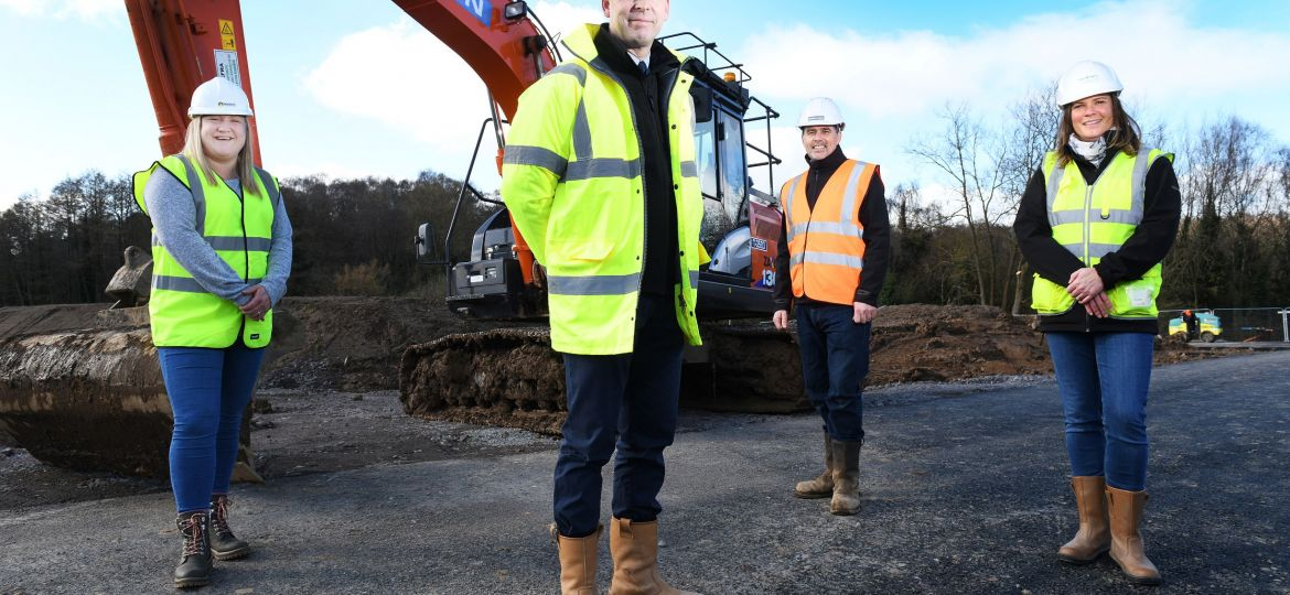 Four people stood on a construction site. These are (left to right) Kirsty Tune, Shane Robinson, Simon Penn, and Jane Kind.