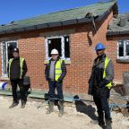 Wayne Noteman, Unity's regeneration director (right) with Josh Paterson, Torpoint director (centre) and Mick Rogers, Torpoint site manager (left), outside one of the new Dale Lane properties.