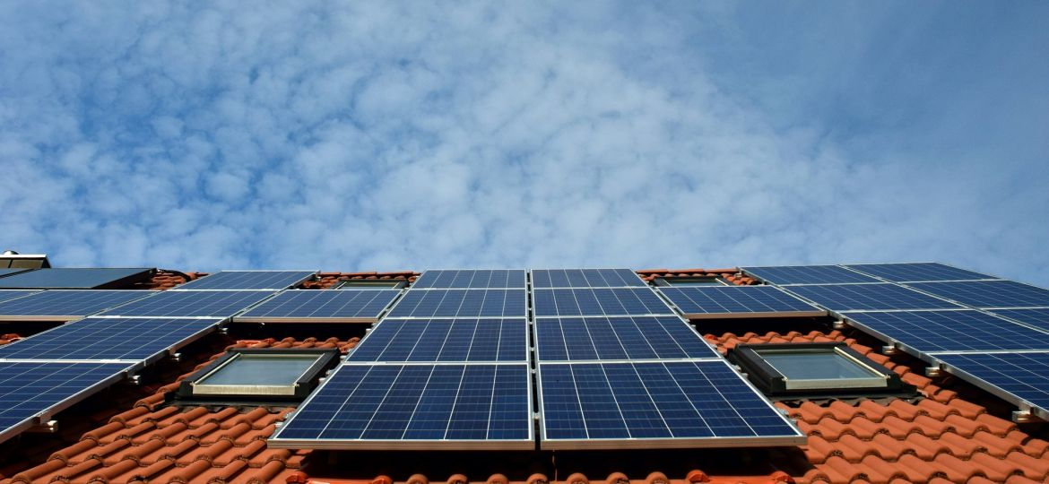 Solar panels on the side of a housing block.