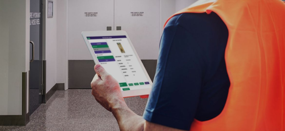 Engineer inspects fire doors, with realtime reporting using PROP-FS